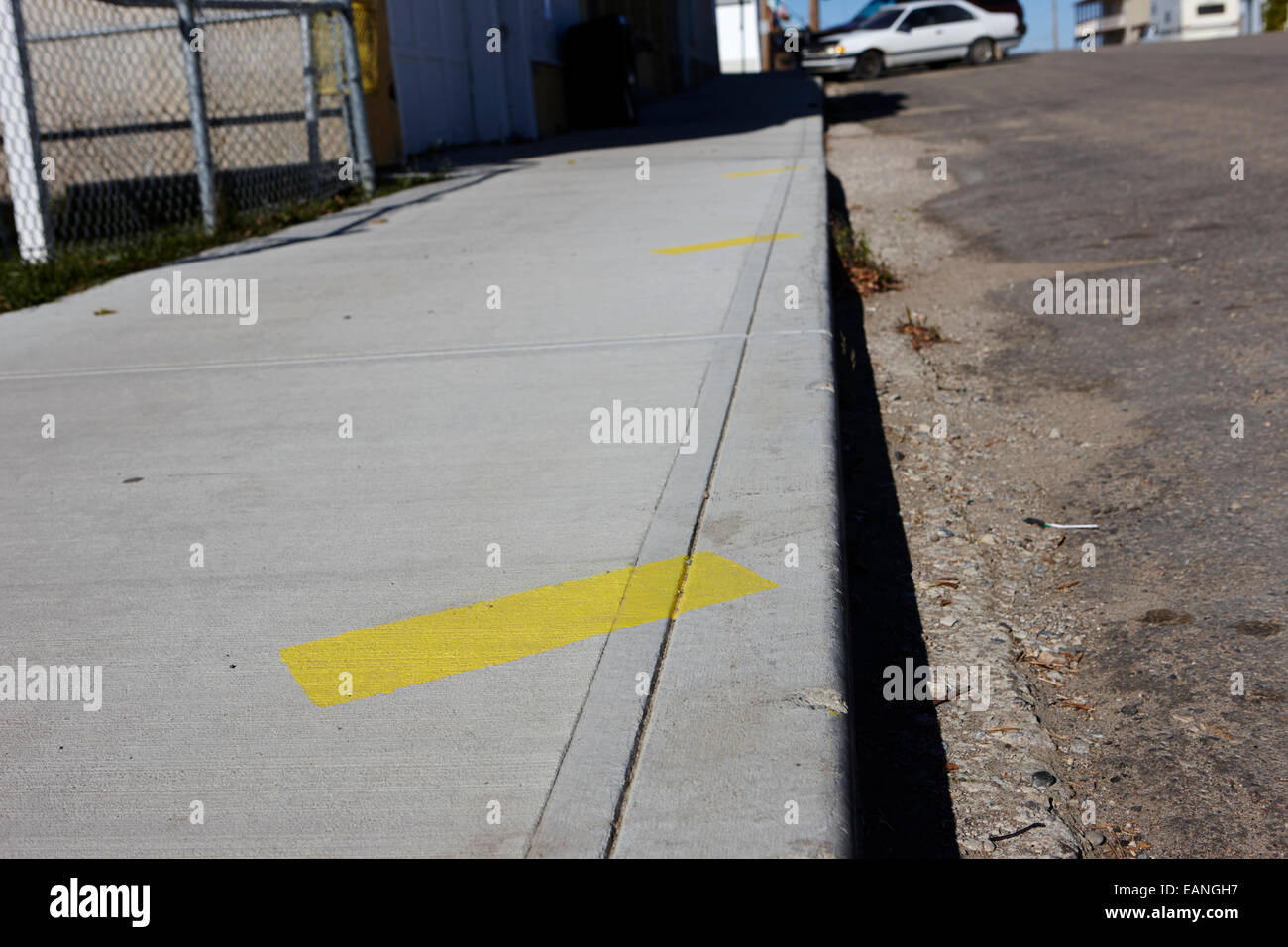 park diagonally markers on the sidewalk of main street hafford Saskatchewan Canada - Stock Image