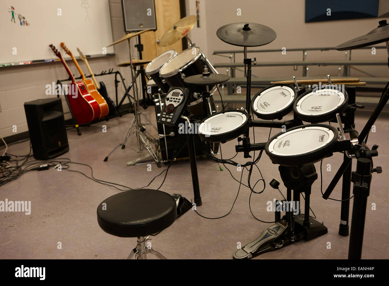 electronic and acoustic drum kit in a music training room - Stock Image