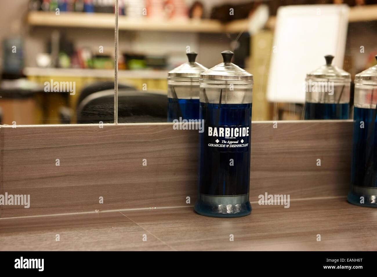 barbicide disinfectant solution in a hairdressers salon - Stock Image