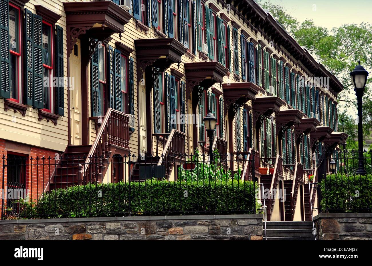 NYC:  1882 two story wooden row houses with stairway stoops and basement entry doors on Sylvan Terrace - Stock Image