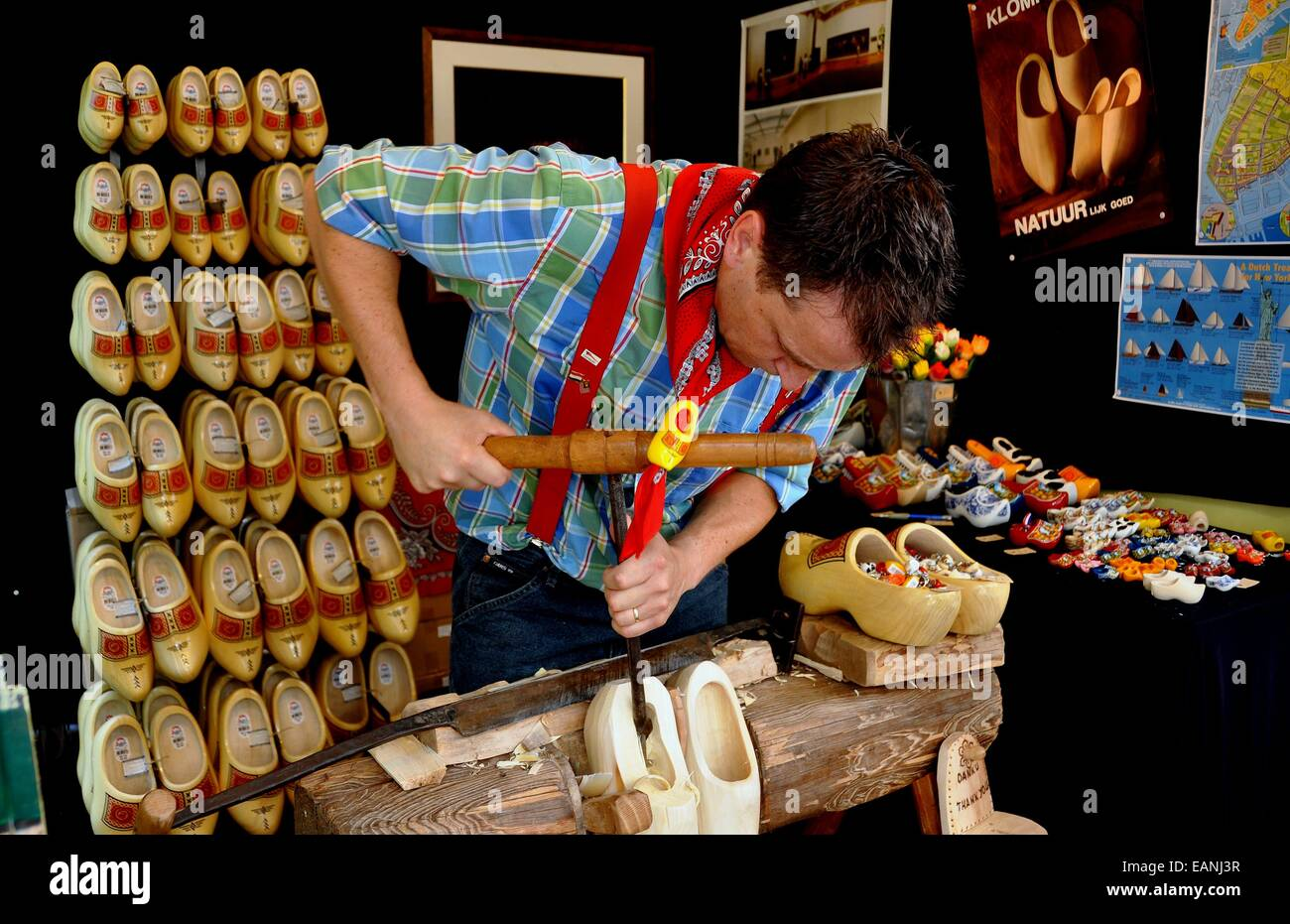 Nyc Craftsman Fashioning A Pair Of Wooden Shoes Called Klompen In