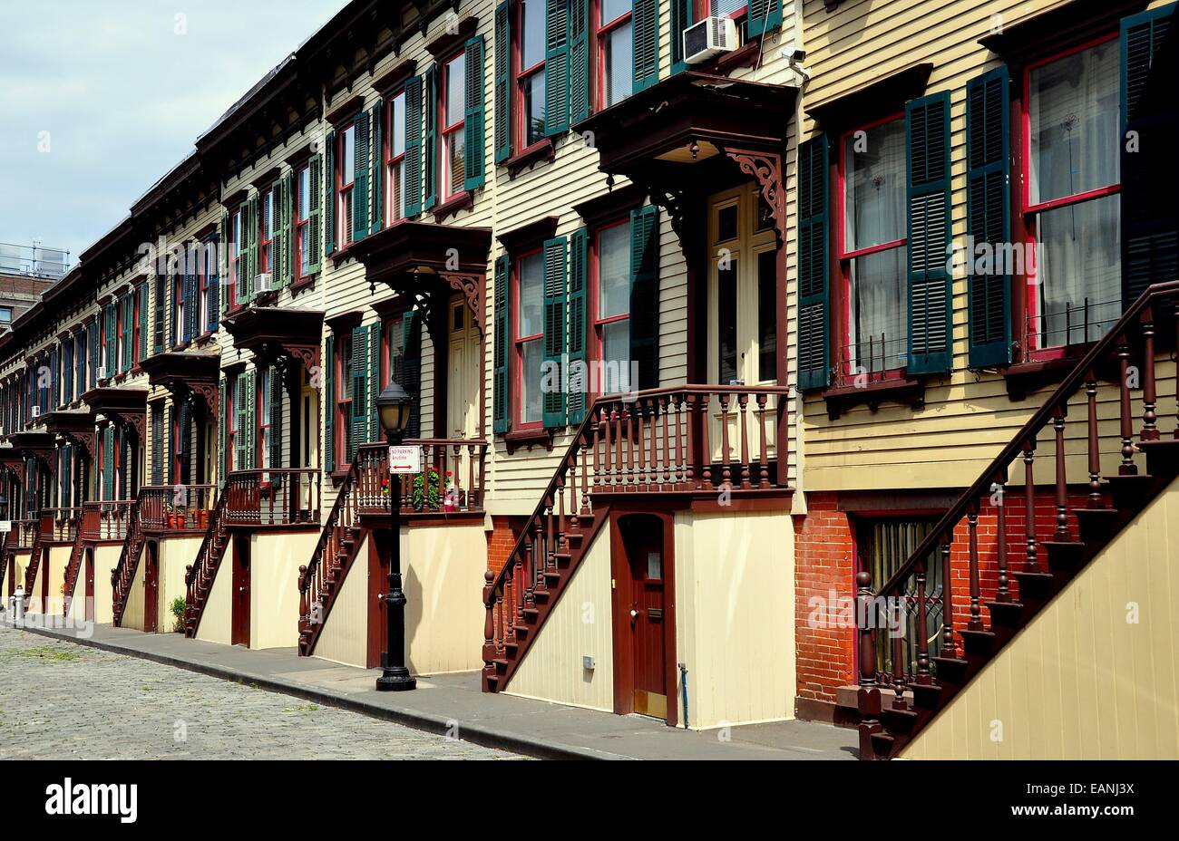 NYC:  Unique two story 1882 wooden row houses with stairway stoops and basement entry doors on Sylvan Terrace * - Stock Image