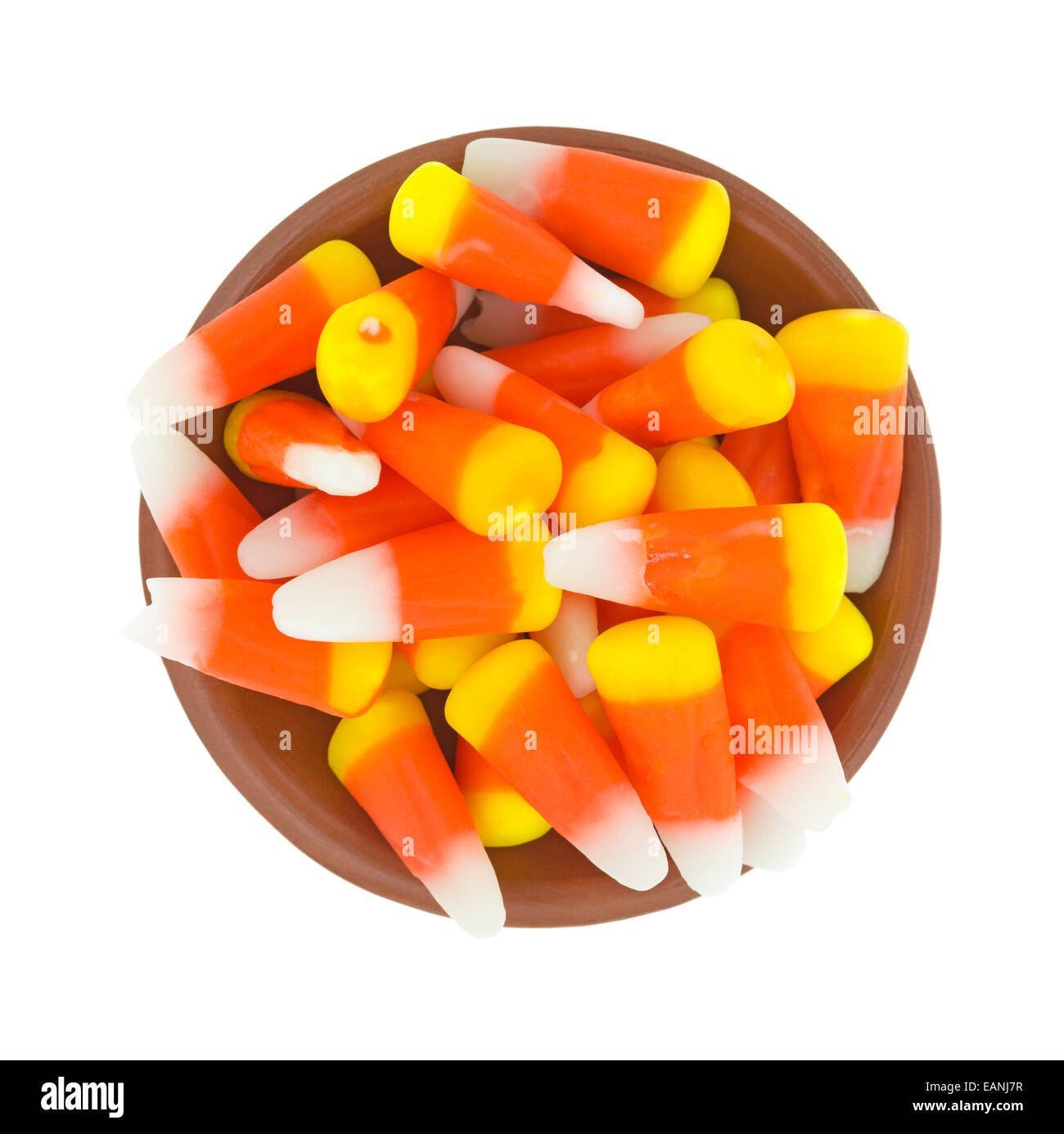 top view of halloween candy corn kernels in a small bowl on a white
