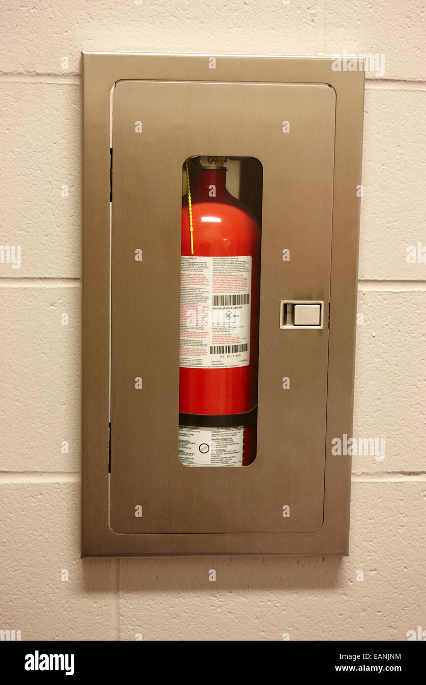 fire extinguisher access in a municipal building - Stock Image
