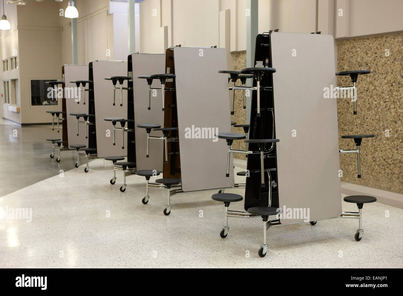 mobile folding table canteen dining units in a high school - Stock Image