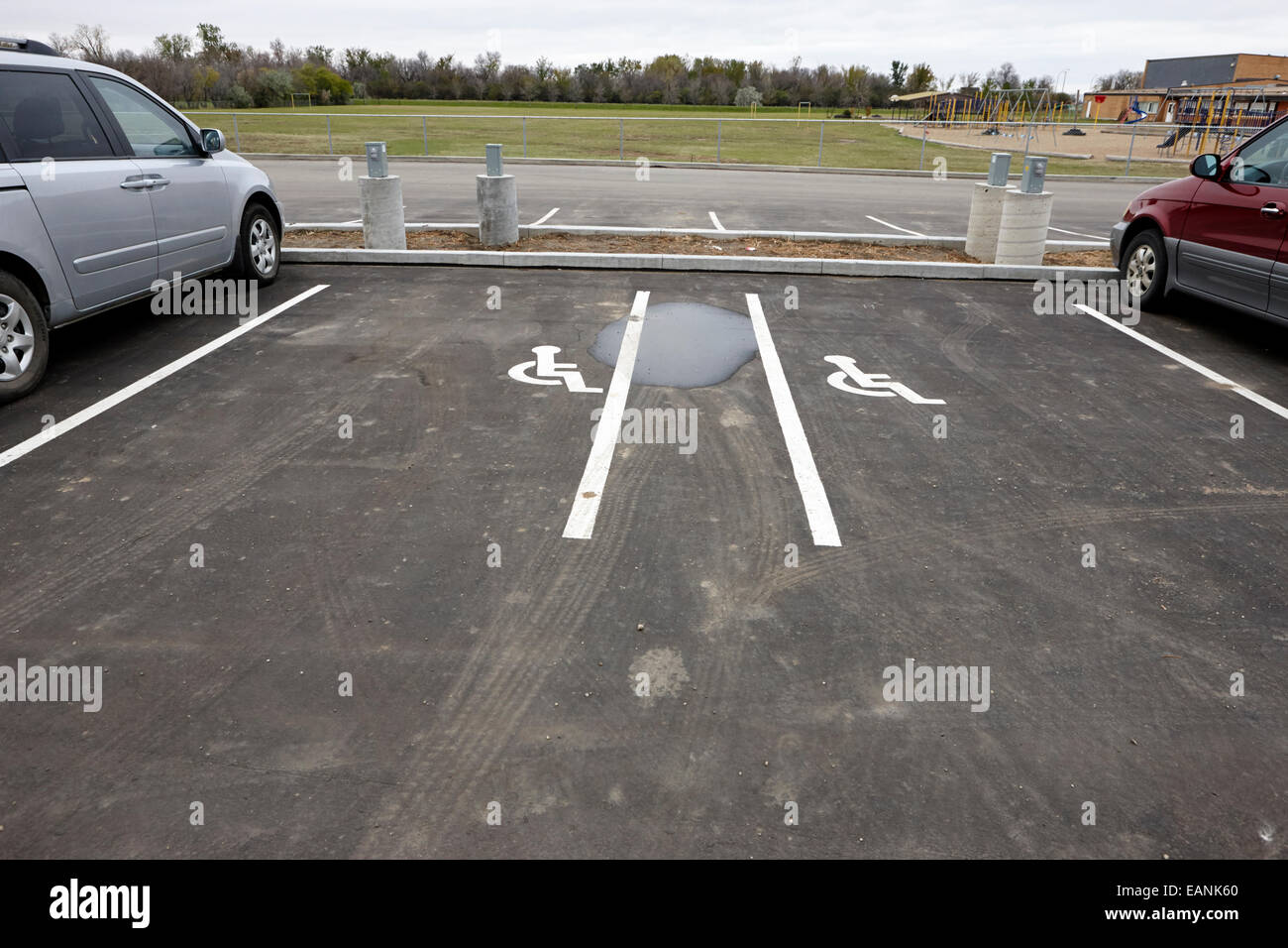 disabled parking bays in parking lot Saskatchewan Canada - Stock Image