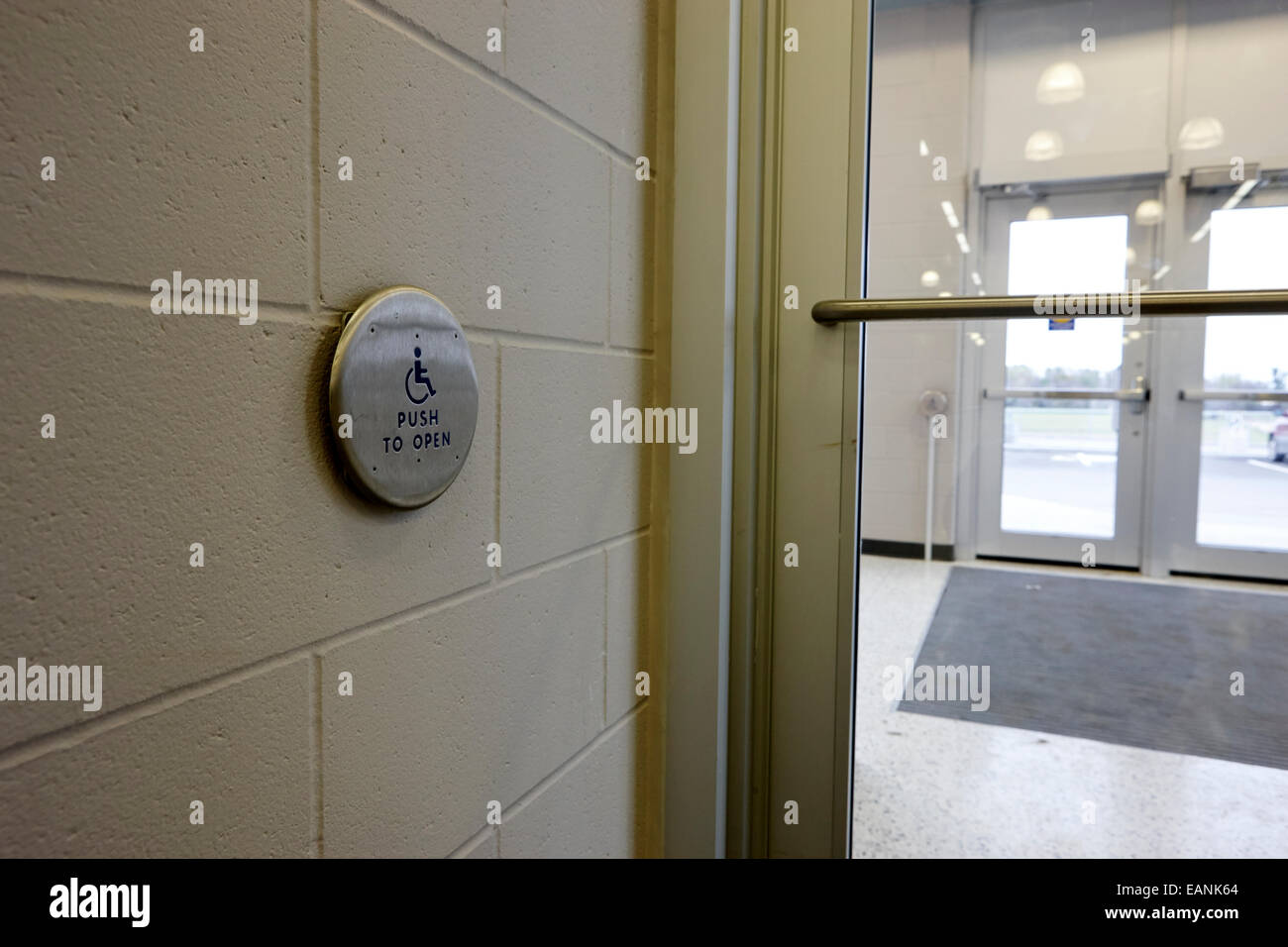 push to open disability access door operation button Saskatchewan Canada - Stock Image
