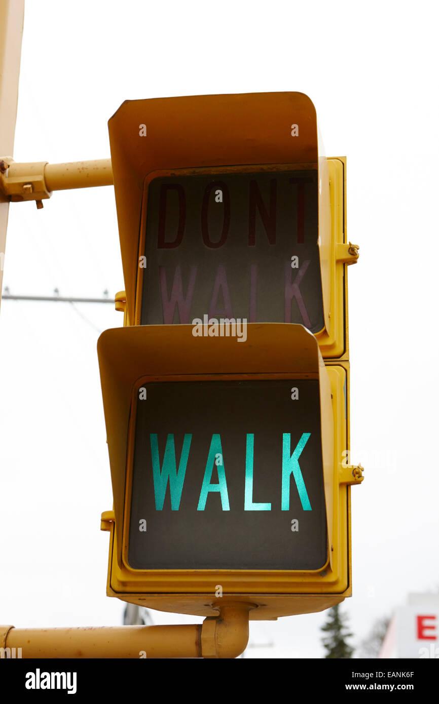 green walk crosswalk crossing lights north america - Stock Image
