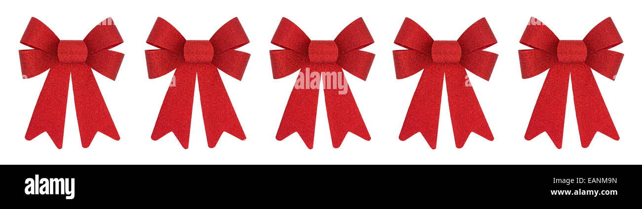 a row of vibrant red christmas bows on a white background stock image - Red Christmas Bows