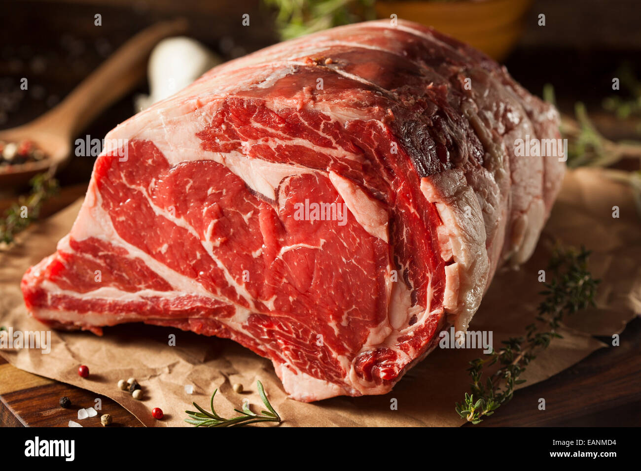 Raw Grass Fed Prime Rib Meat with Herbs and Spices - Stock Image