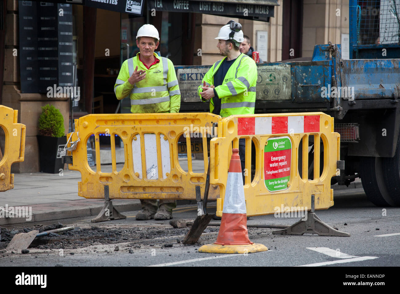 roadworks road repairs resurface resurfacing tarmac tar asphalt asphalting roads road gang pot hole highway highways - Stock Image