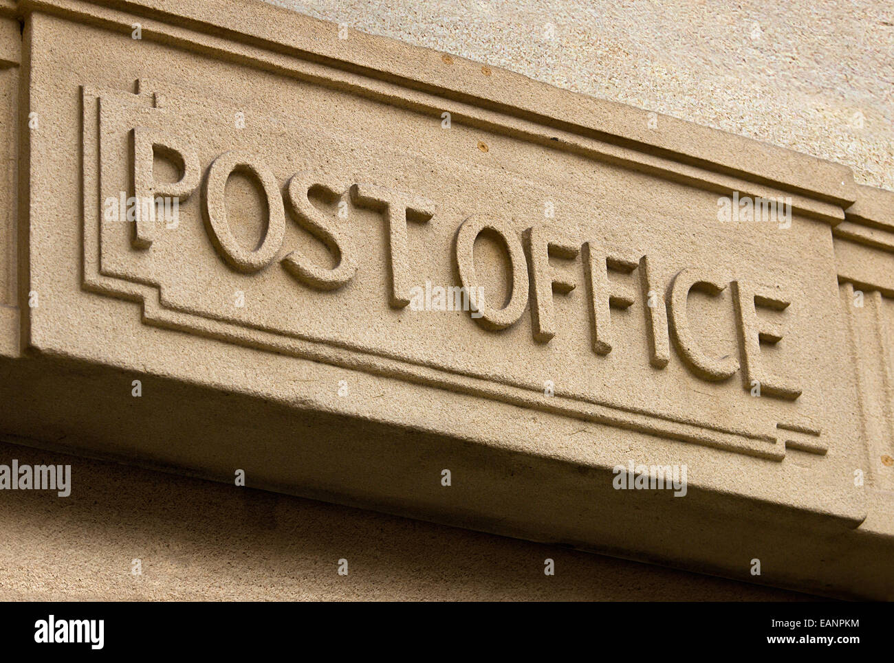 Post Office Building entrance carved in stone above the door of the postal service - Stock Image