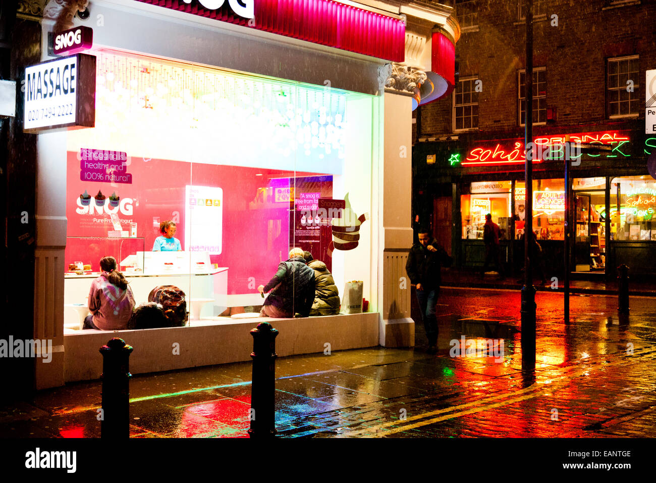 Corner of a street in Soho on a wet and cold winter night, London - Stock Image