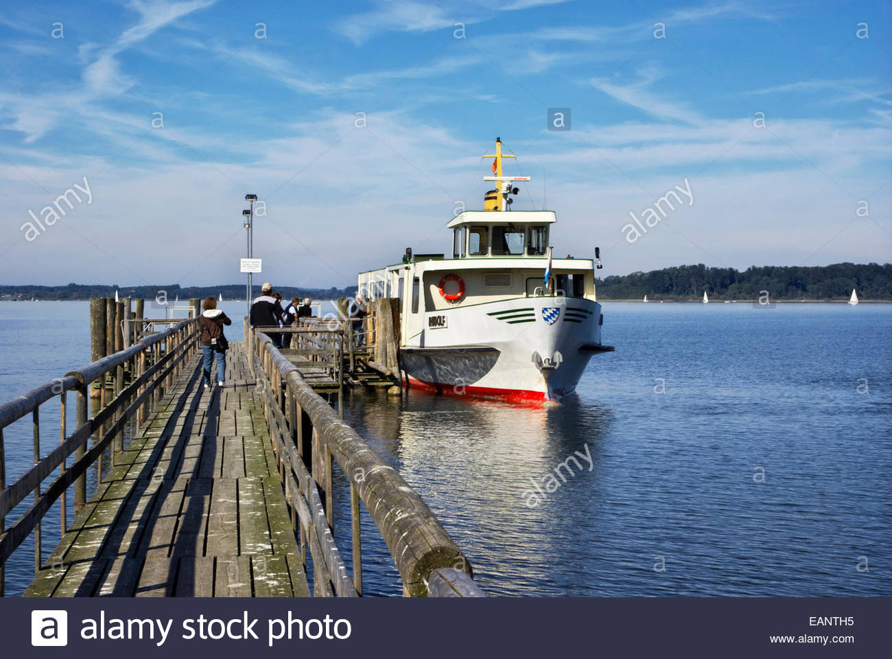 Tourists board an excursion boat for a trip to Herreninsel, an island in the Chiemsee, or Bavarian Sea, Germany. - Stock Image