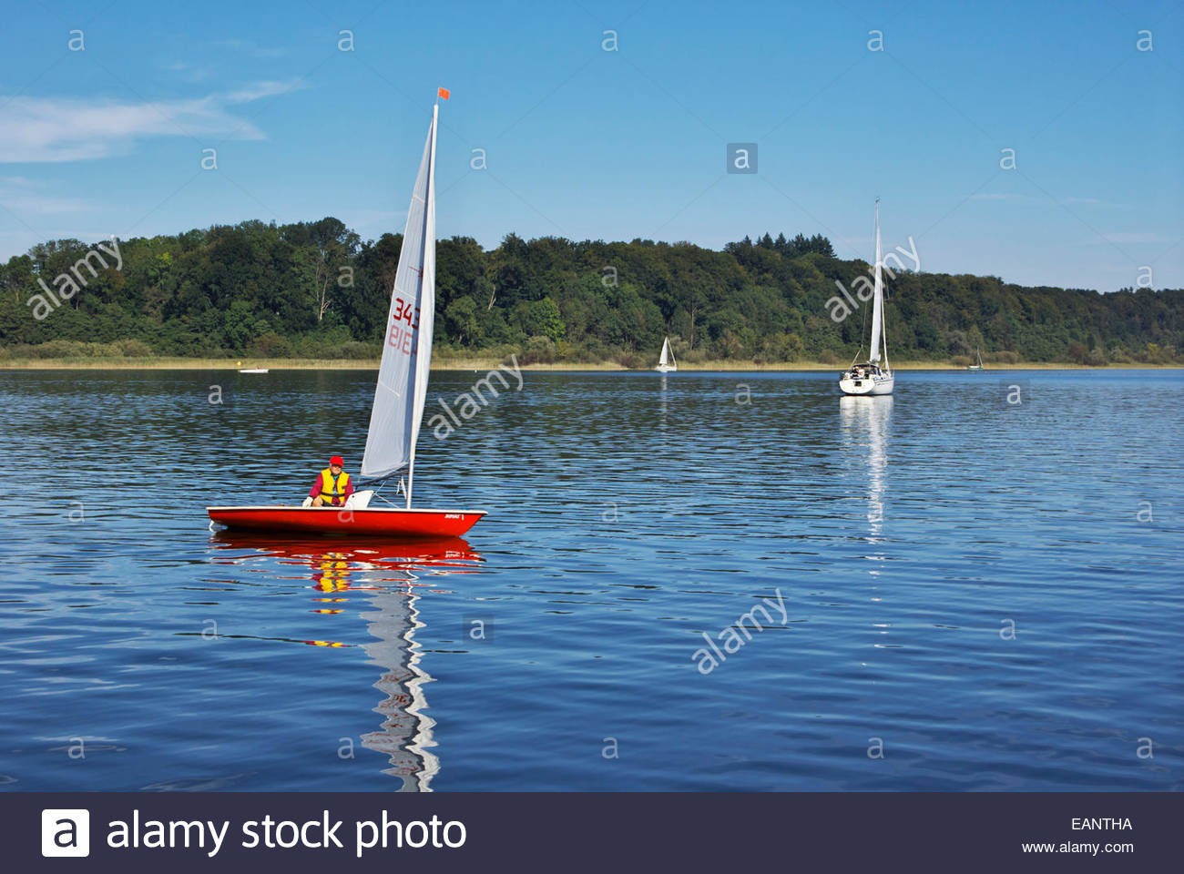 Small and medium size sailboats ply the waters of the Chiemsee, or Bavarian Sea. - Stock Image