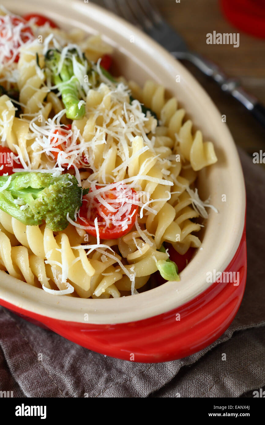 Pasta with roasted broccoli in a baking dish, italian food - Stock Image