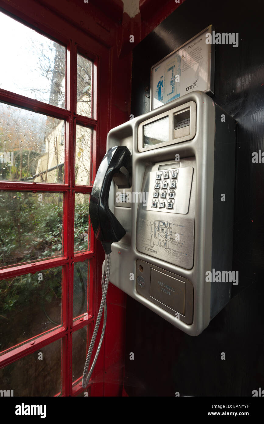 traditional old fashioned unused red telephone box illustrating changing communication cultures and redundant old Stock Photo