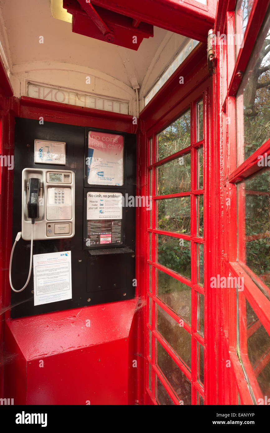 traditional old fashioned unused red telephone box illustrating changing communication cultures and redundant old - Stock Image