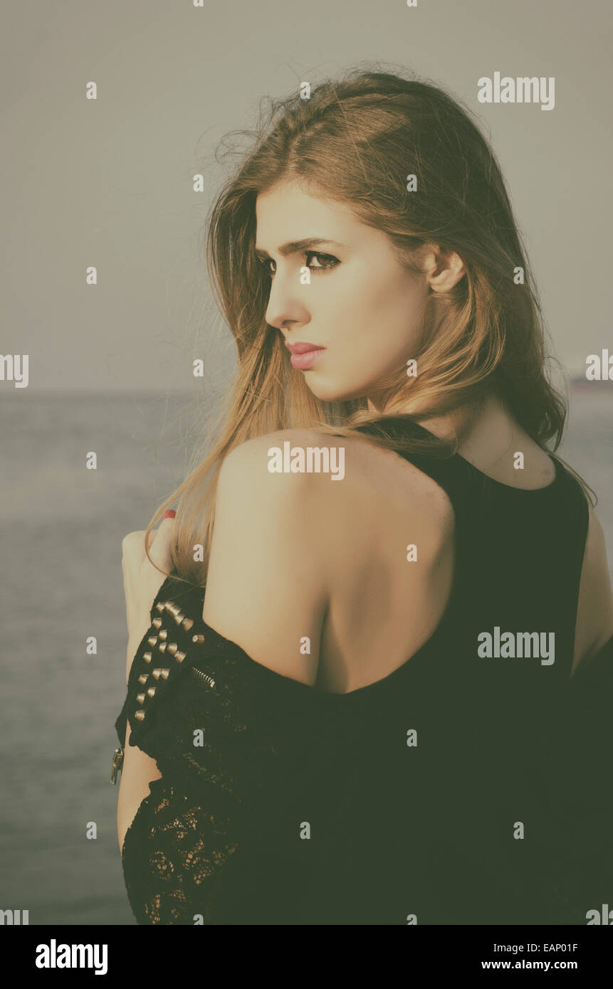 Anxious Woman Looking Over Her Shoulder Stock Photos