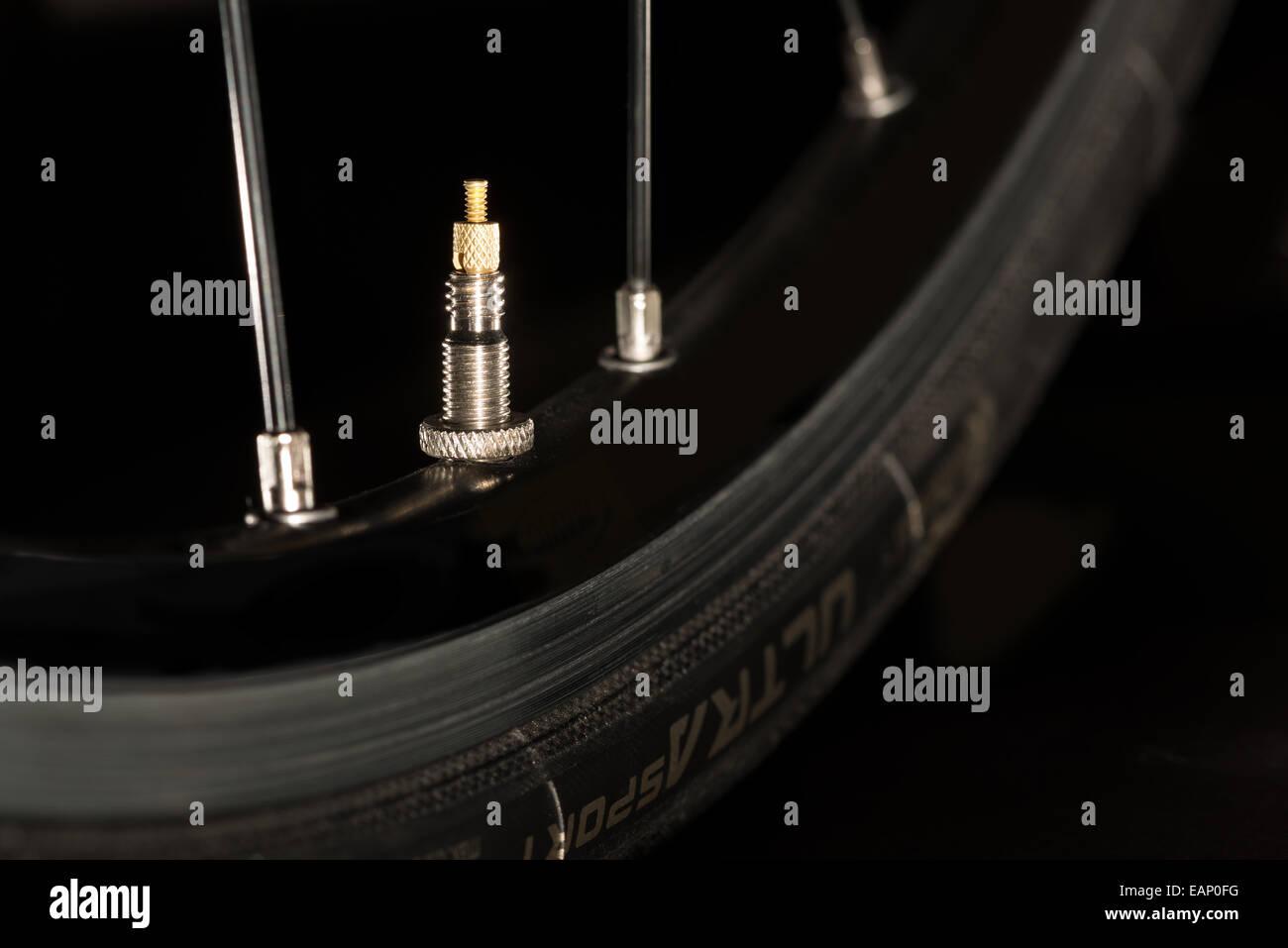 racing road bike wheel rim spokes and valve - Stock Image