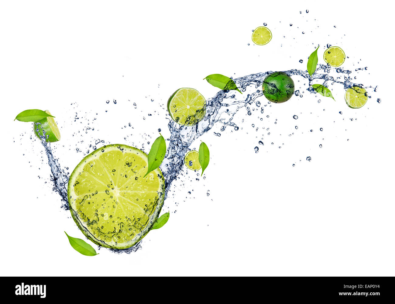 Fresh limes in water splash, isolated on white background - Stock Image
