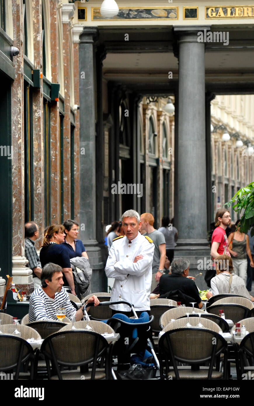 Brussels, Belgium. Waiter at a cafe in the Galeries Hubert. - Stock Image