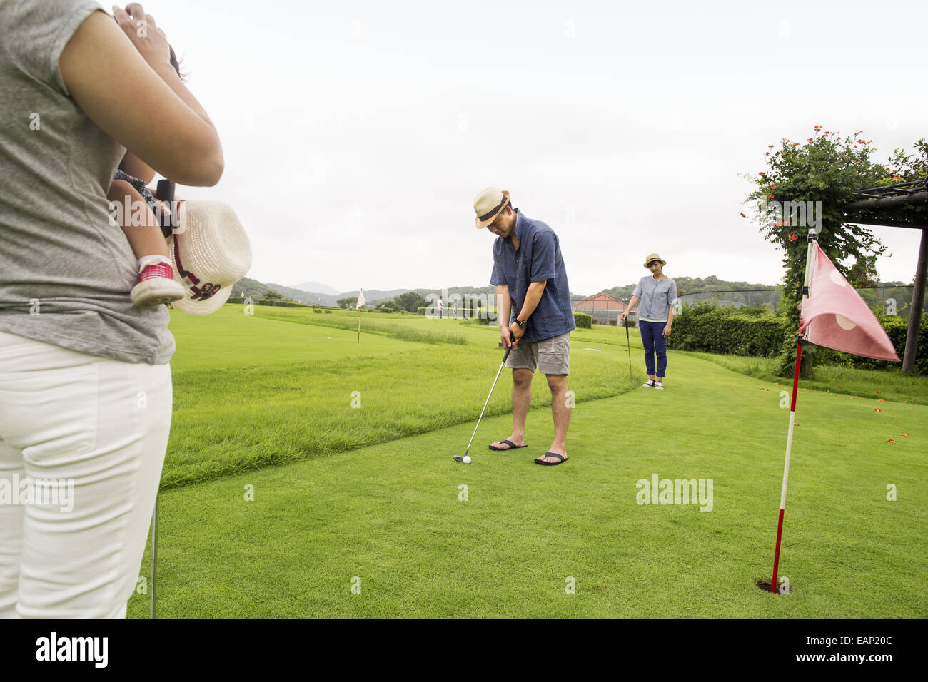 Family on a golf course. - Stock Image