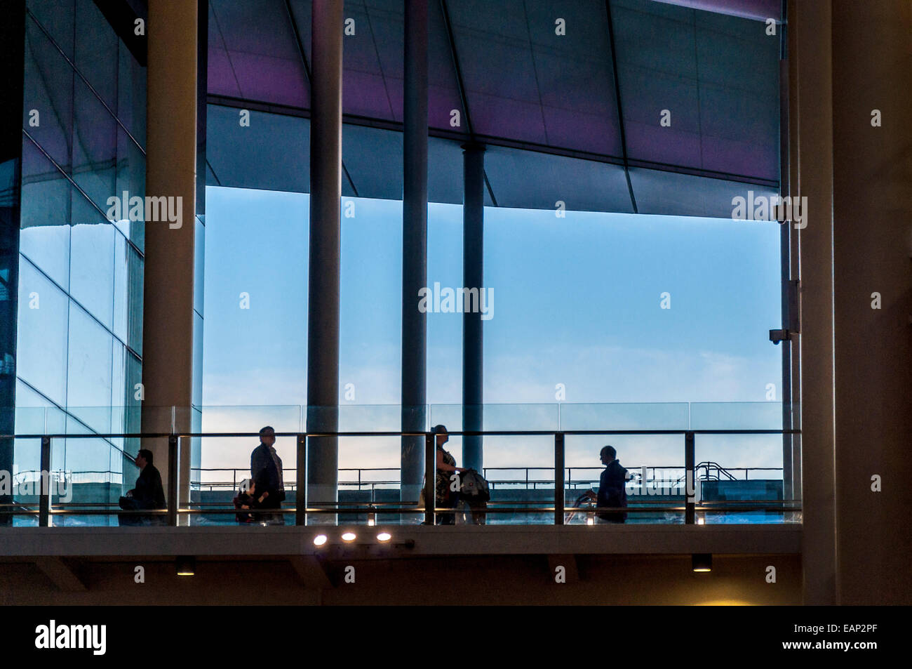 Terminal Two Passengers on walkway at new terminal building at London Heathrow Airport - Stock Image