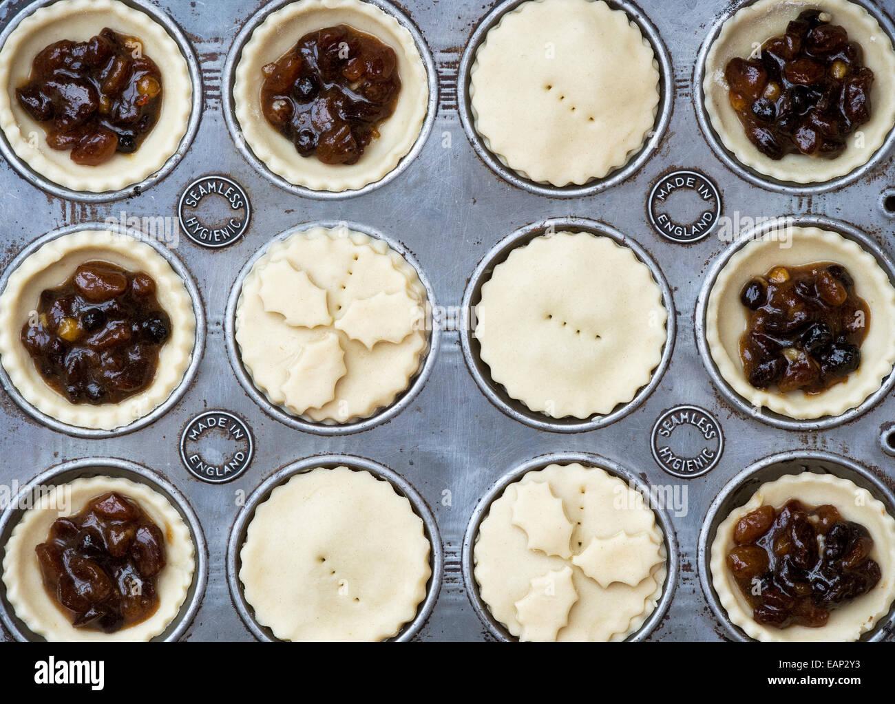 Baking Homemade Christmas mince pies - Stock Image