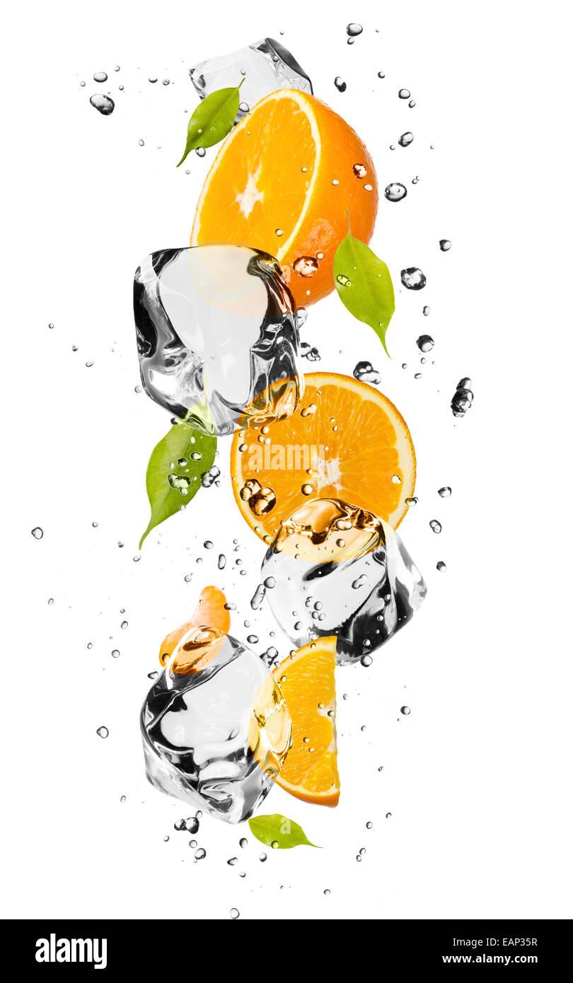 Oranges with ice cubes, isolated on white background - Stock Image
