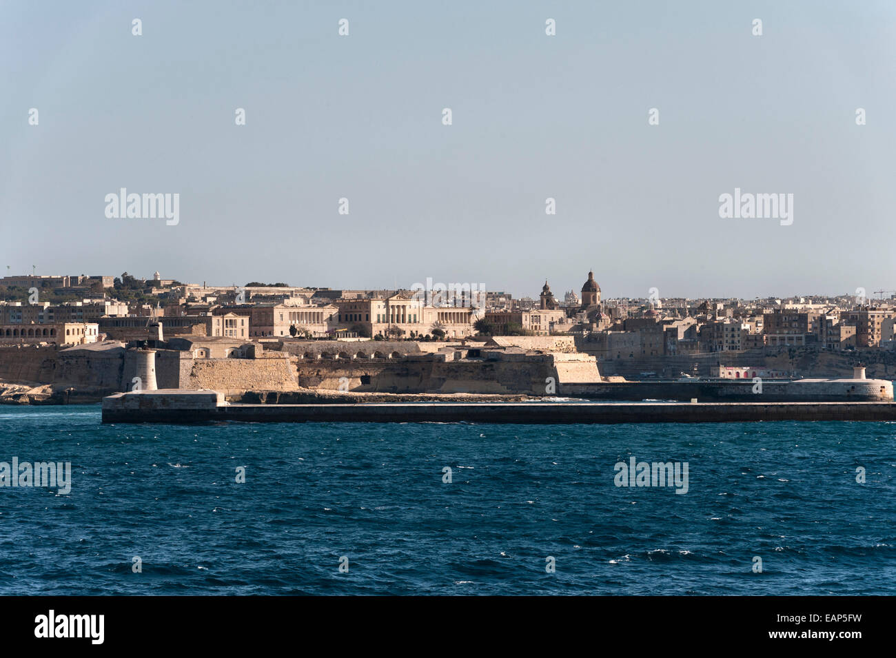 Valletta, Malta, from the sea - Saint Elmo lighthouse at the entrance to the Grand Harbour - Stock Image