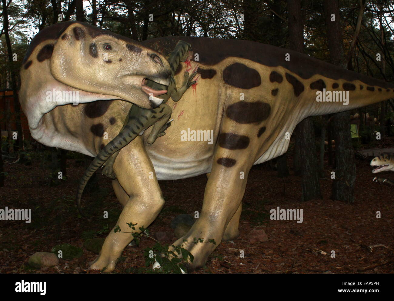 Predatory Deinonychus attacking an Iguanodon (Cretaceous era) Lifelike dino statues at  Dinopark Amersfoort Zoo, - Stock Image