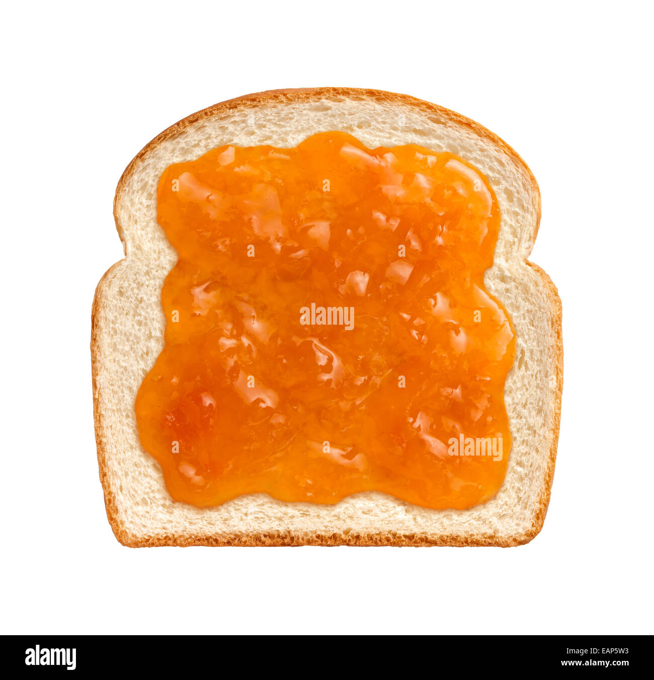 Apricot Preserves on a Single Slice of white bread isolated on a white background. - Stock Image