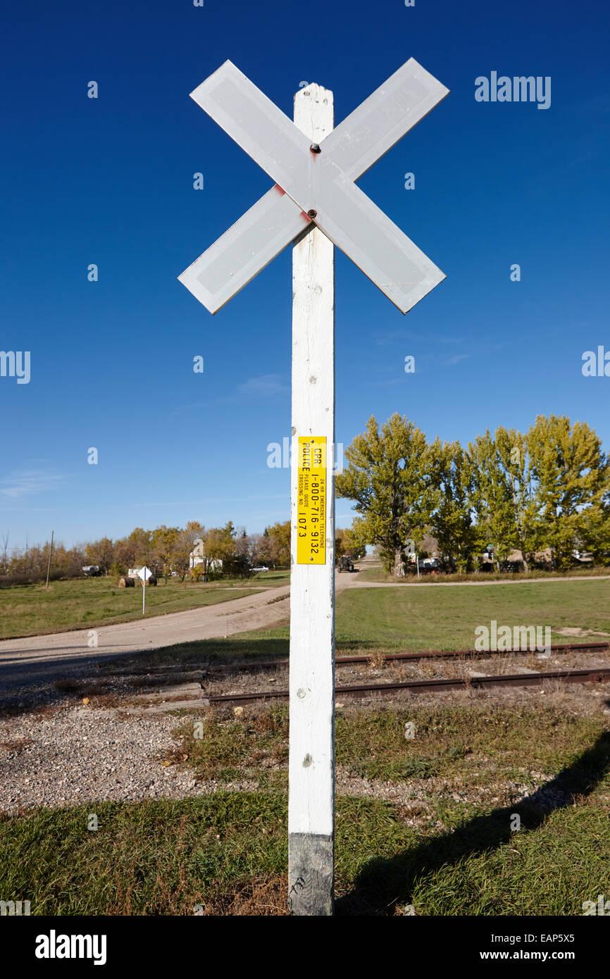 sun bleached railroad crossing sign Saskatchewan Canada - Stock Image