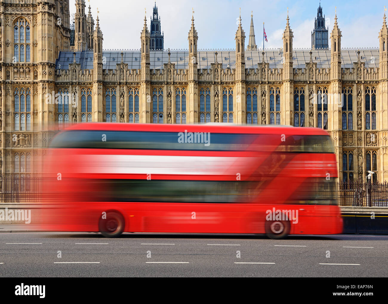 London Bus Going Past the Houses of Parliament, Westminster, London, UK. - Stock Image