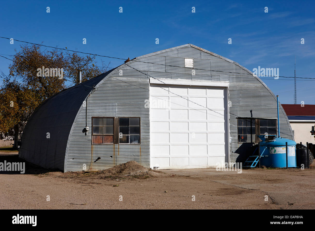 old nissen quonset hut used as a garage in bengough Saskatchewan Canada - Stock Image