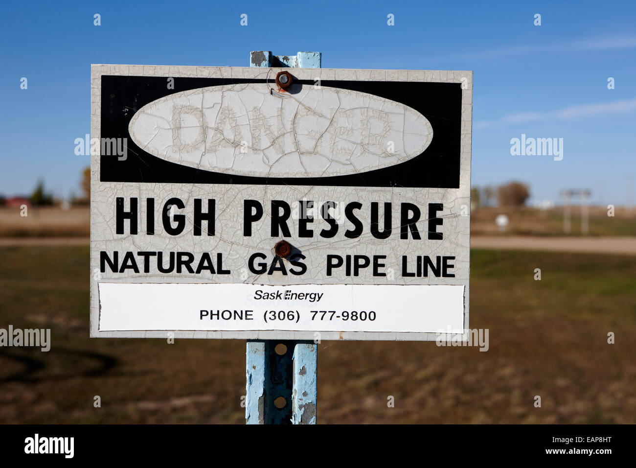 danger sign for high pressure natural gas pipeline underground bengough Saskatchewan Canada - Stock Image