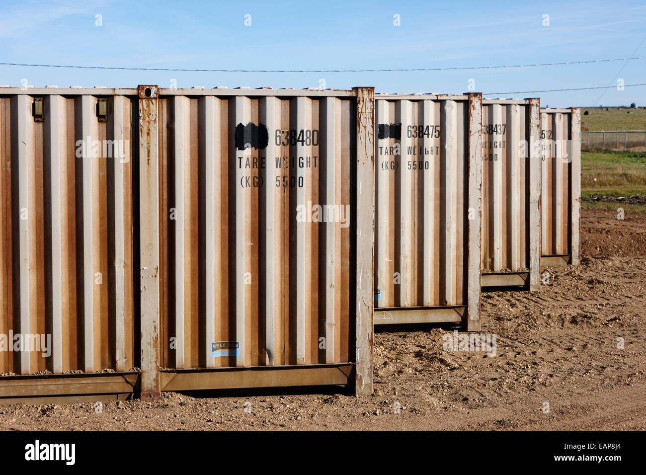 old metal shipping containers used as storage Saskatchewan Canada - Stock Image