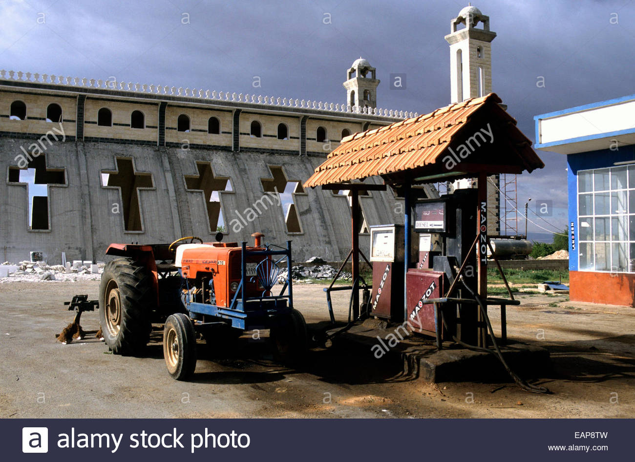 A gas pump station in front of a church, Homs, Syria. - Stock Image