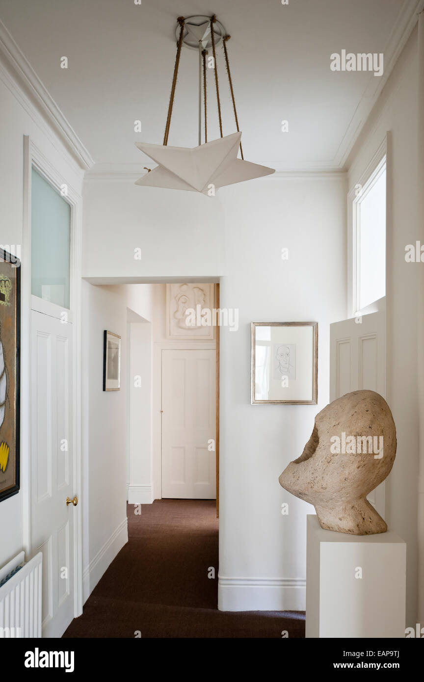 Veronika van Eyck sculpture on plinth in hallway with plaster star light - Stock Image