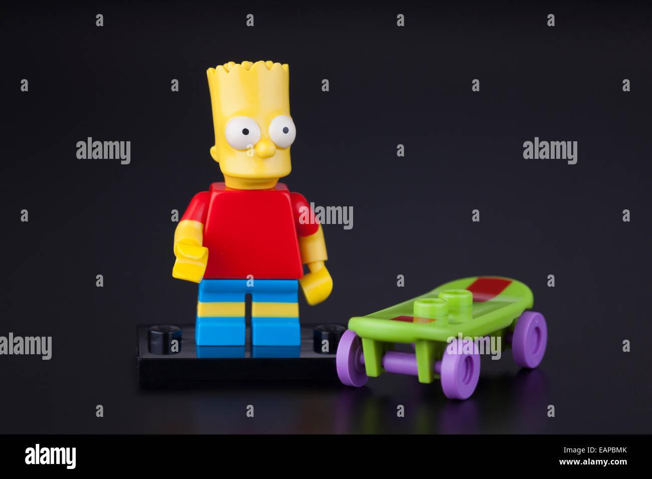 Tambov, Russian Federation - April 30, 2014 Lego Bart Simpson minifigure with skateboard on black background. Studio - Stock Image