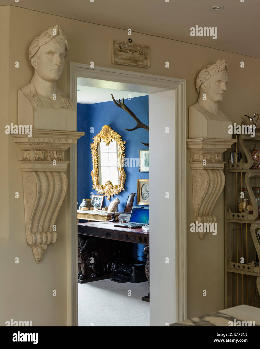 Pair of Julius Caesar busts flank the entrance to a study - Stock Image