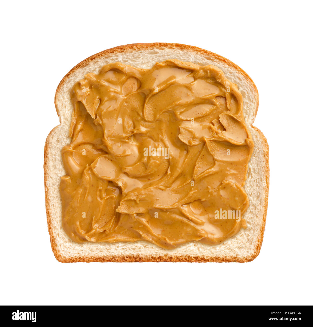 Aerial view of swirling peanut butter on a  slice of white bread. The subject is isolated on a white background. - Stock Image