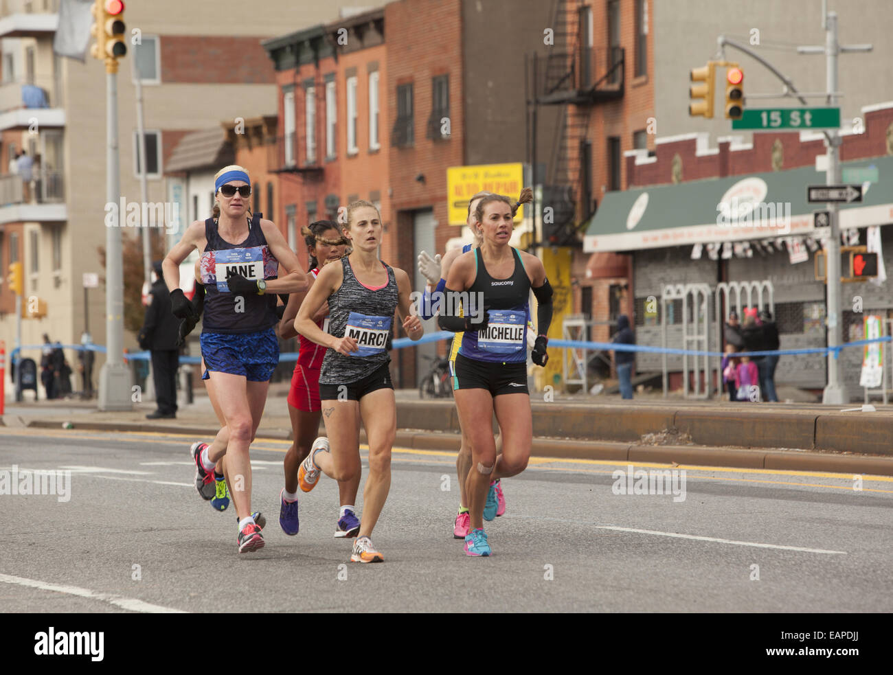 2014 NY City Marathon: Female front  runners cruise along 4th Ave. in Brooklyn. - Stock Image