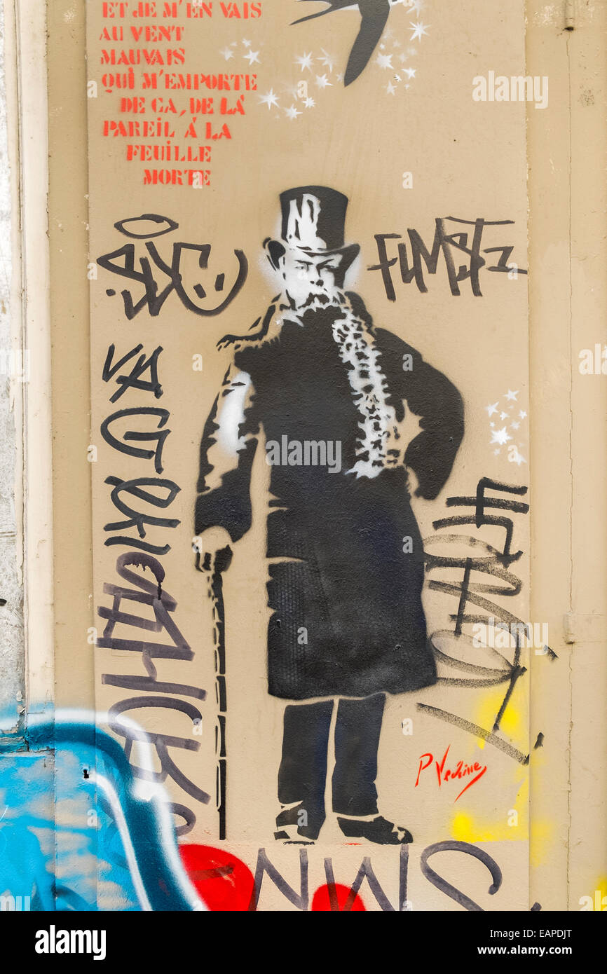 graffito showing a portrait of french poet paul verlaine next to the last verse of the poem chanson d´automne, - Stock Image