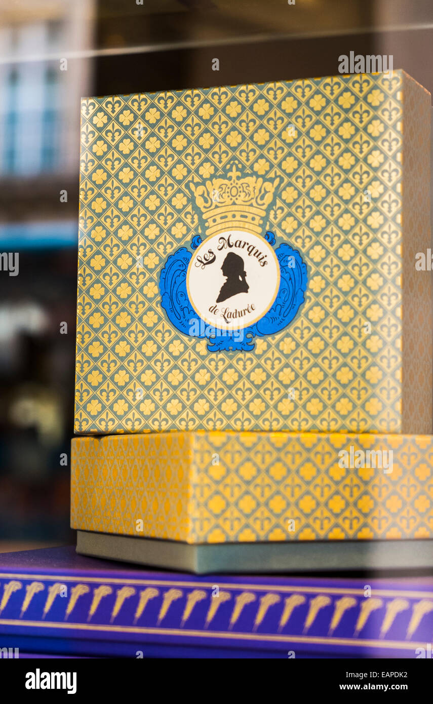 gift boxes with company blazon in the shop window of the luxury confectionary retailer ladurée, rue royale, - Stock Image