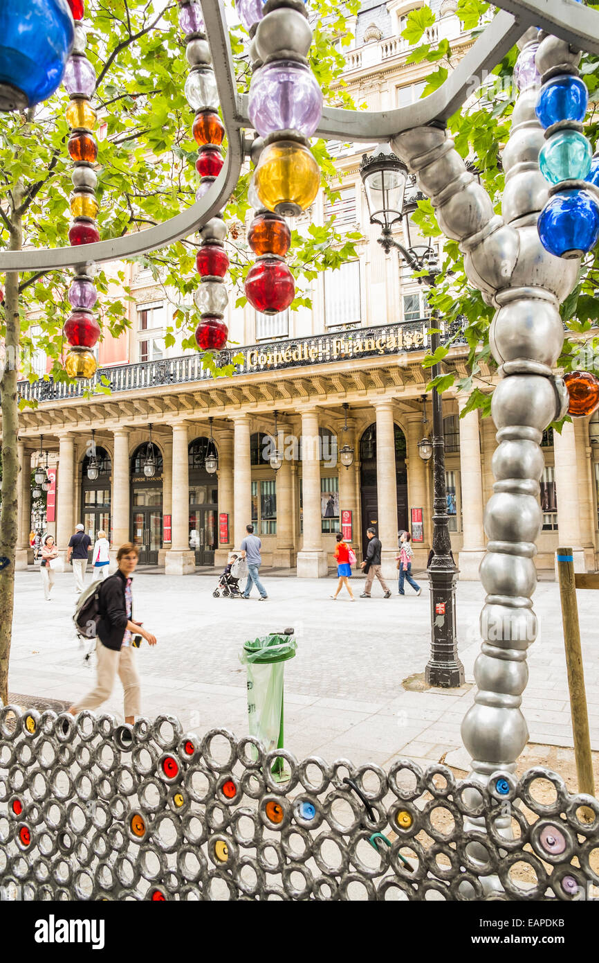 comédie francaise seen through the glass bead construction of the entrance of the metro station palais-royal - Stock Image
