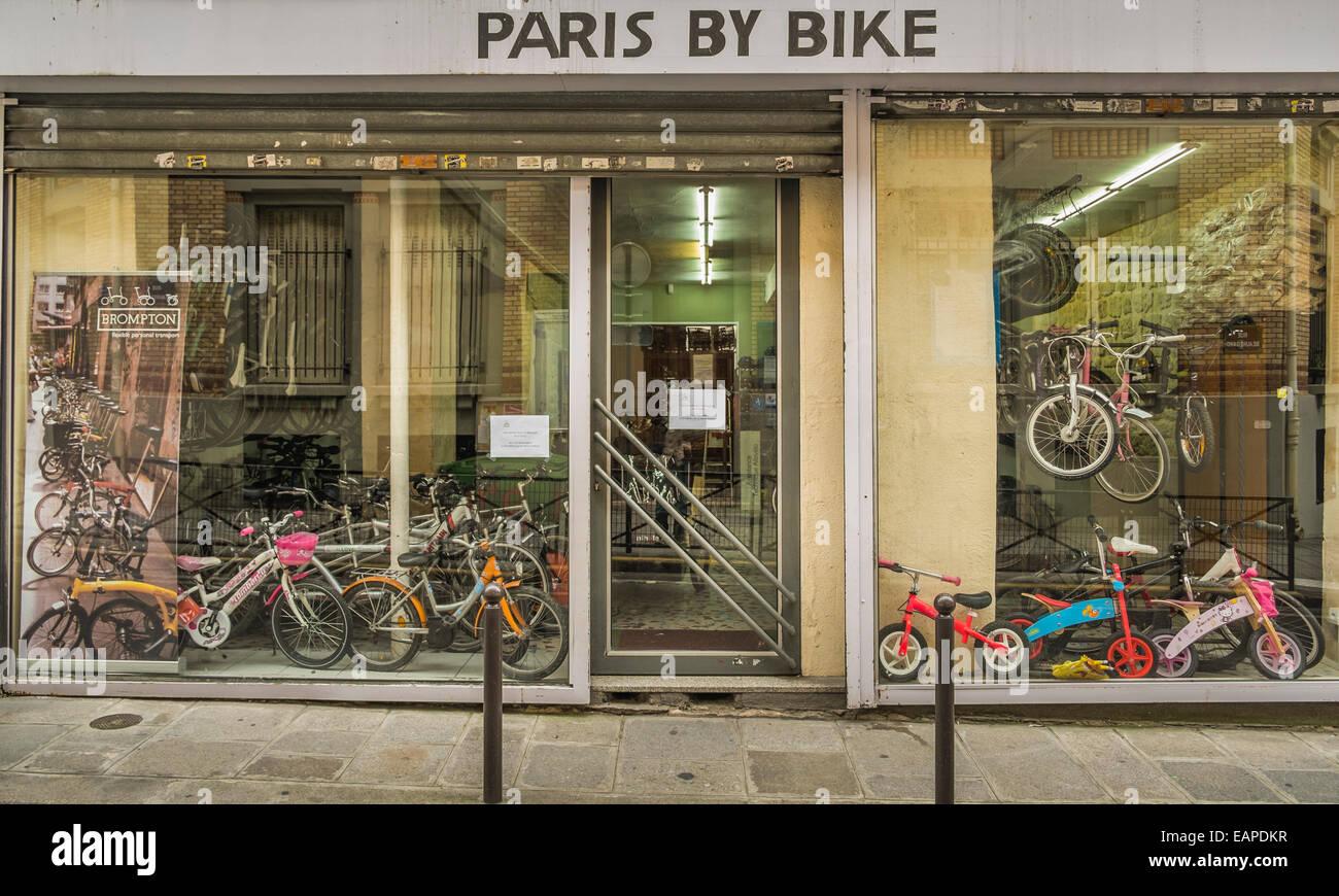 shop window of bicycle store paris by bike, paris, ile de france, france - Stock Image