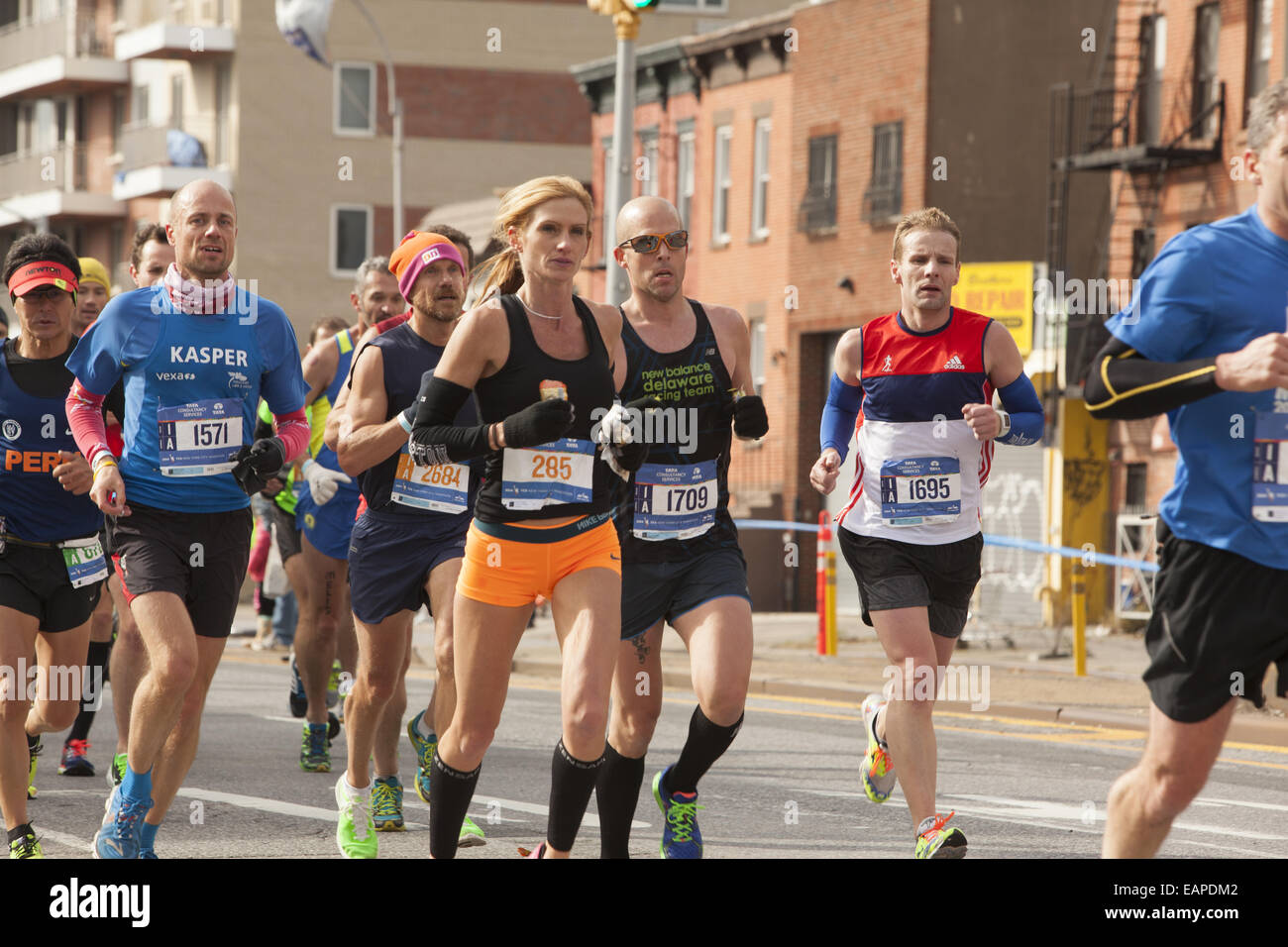 2014 NY City Marathon runners cruise along 4th Ave. in Brooklyn. - Stock Image