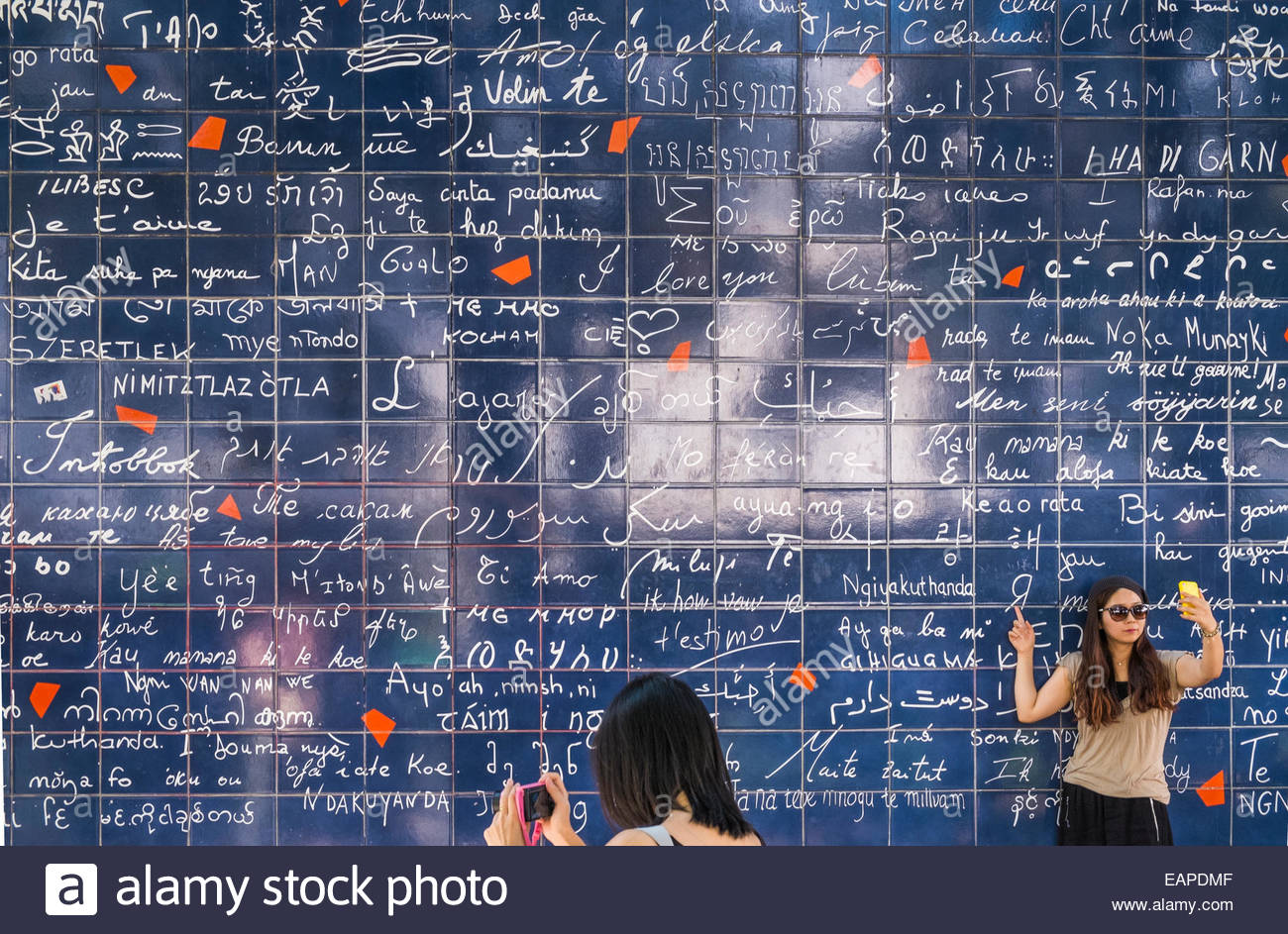 asian tourists in front of the so-called i-love-you-wall, buttes montmartre, place des abbesses, square jehan rictus, - Stock Image